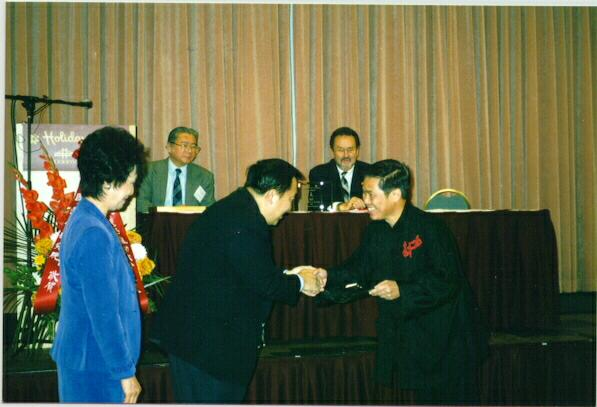 "Sifu Wong receiving the ""Qigong Master of the Year"" award"